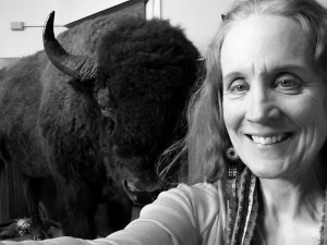 Karen Reinhart takes a selfie with the museum's bison
