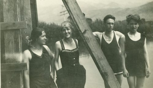 Bathers relaxing along the water