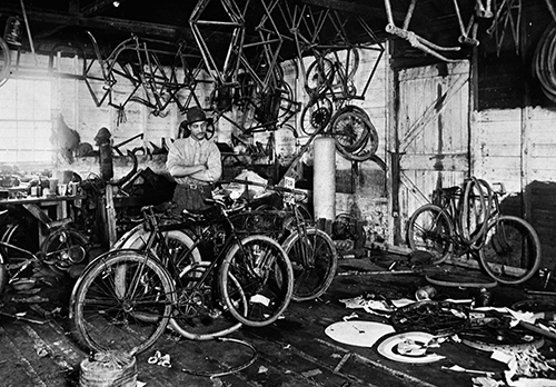 Mark Fox in his bicycle and motorcycle repair shop, Livingston, Montana