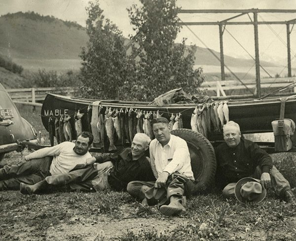 Anglers posing in front of boat and a day's catch