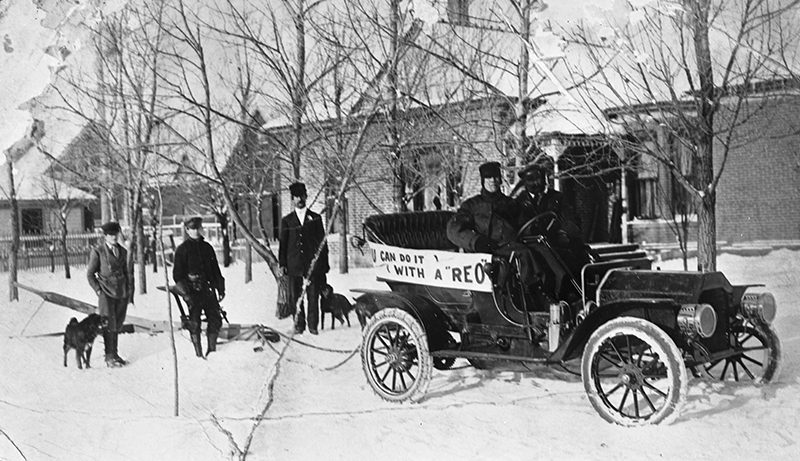 REO automobile pulls a plow