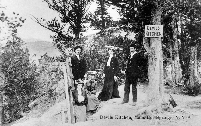 Tourists standing above the Devils Kitchen