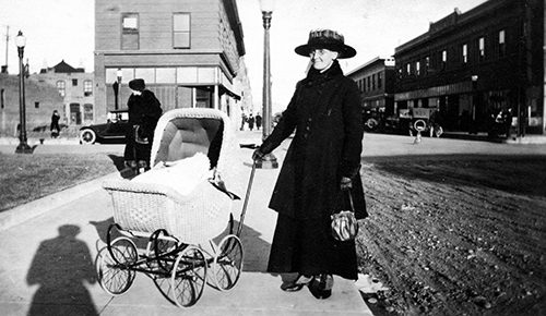 Woman with baby carriage, downtown Livingston